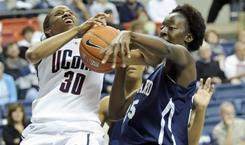 Connecticut's Lorin Dixon, left, and Howard's Julee' O'Neal battle for a rebound during the second half of their game on Saturday in Storrs, Conn. Dixon and the top-ranked Huskies cruised to an 86-25 victory.