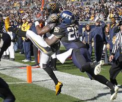 West Virginia wide receiver Tavon Austin, left, makes a touchdown catch in front of Pittsburgh cornerback Ricky Gary during the third quarter