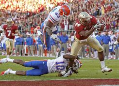 Florida State running back Lonnie Pryor beats the Florida defense to the end zone for a touchdown during the first half.
