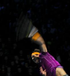 Rafael Nadal of Spain winds up a serve during his three-set victory against Andy Murray of Great Britain on Saturday during the semifinals of the ATP World Tour Finals in London.
