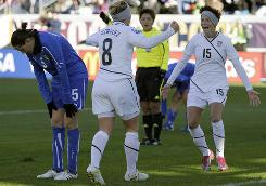 Team USA forward Amy Rodriguez (8) celebrates with teammate Megan Rapinoe after scoring the match's only goal as Italy's Tona Elisabetta hangs her head during the first half.
