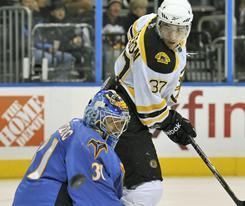 Atlanta Thrashers goaltender Ondrej Pavelec makes a save against Boston Bruins forward Patrice Bergeron during the second period.