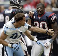 Tennessee's Cortland Finnegan, left, and Houston's Andre Johnson brawled on Sunday.