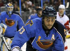 Atlanta's Ondrej Pavelec, left, and Dustin Byfuglien were the NHL's top two stars of the week.