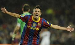"Barcelona's David Villa celebrates after scoring one of his two goals during the thoroughly one-sided Spanish league ""clasico."""