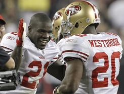Niners running back Brian Westbrook, right, celebrates his touchdown with teammate Frank Gore during their game against the Cardinals in Glendale, Ariz. Westbrook, who rushed for 136 yards, had his biggest day since running for 167 yards as a member of the Philadelphia Eagles against the Atlanta Falcons in 2008.