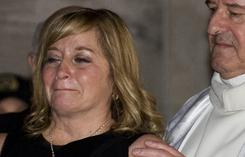 Pat Burns' widow, Line, leaves the former NHL coach's funeral in Montreal Monday.