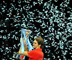 Roger Federer of Switzerland shows off his prize after defeating his top rival, Rafael Nadal of Spain, in the final of the season-ending ATP World Tour Finals in London on Sunday.