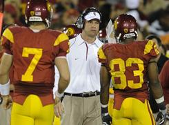 Southern California coach Lane Kiffin, chatting with quarterback Matt Barkley, left, and wideout Ronald Johnson during an October loss to Oregon, is disappointed in his team's 7-5 record but is optimistic about 2011.