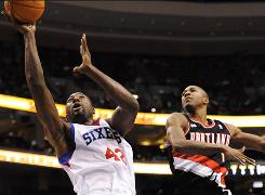Philadelphia 76ers forward Elton Brand shoots as Portland Trail Blazers guard Armon Johnson defends during the first quarter Tuesday. Brand finished with 18 points and the 76ers won 88-79.