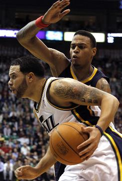 Jazz guard Deron Williams drives past Pacers guard Brandon Rush during the second half on Wednesday. The Jazz won 110-88  their seventh consecutive win.