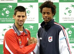 Novak Djokovic of Serbia, left, and Gael Monfils of France share a calm moment before the storm begins Friday in the Davis Cup final in Blegrade.