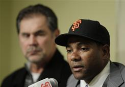 New Giants shortstop Miguel Tejada, at a Thursday news conference with manager Bruce Bochy, left, played 156 games last season with the Orioles and Padres, batting .269 with 15 homers, 26 doubles and 71 RBI between the two clubs.