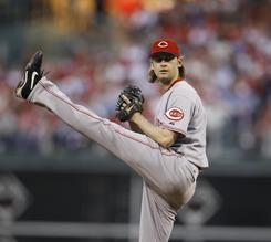 Starting pitcher Bronson Arroyo, 33, will remain in Cincinnati through 2013 after winning a team-high 17 games last season for the Reds.