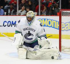 Canucks goalie Roberto Luongo makes one of his 32 saves en route to his second shutout of the season and 53rd of his career.