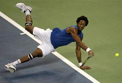 Gael Monfils of France shows off his athleticism in his straight-sets victory Friday against Janko Tipsarevic of Serbia in the first match of the Davis Cup final in Belgrade, Serbia.