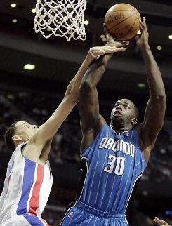 Orlando Magic forward Brandon Bass takes a shot against Detroit Pistons forward Austin Daye in the first half on Friday. Bass led the Magic to a 104-91 victory with 27 points.