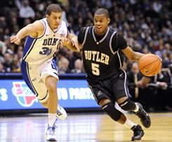 In a rematch of last season's NCAA title game, Seth Curry, left, and Duke again got the better of Ronald Nored and Butler. The top-ranked Blue Devils gradually pulled away in Saturday's 82-70 win.