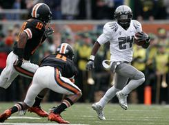 Oregon running back Kenjon Barner finds running room against the Oregon State defense during the first half.