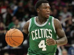 Celtics guard Nate Robinson brings the ball up court during the second quarter.