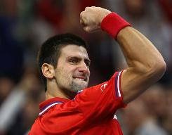 Novak Djokovic of Serbia celebrates during his straight-sets victory against Gael Monfils of France on Sunday in the Davis Cup final in Belgrade.