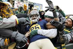 Packers wide receiver Greg Jennings celebrates with fans after his 57-yard touchdown catch in the first half against the 49ers. Jennings scored twice in Green Bay's win.