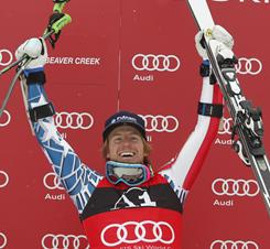 U.S. ski racer Ted Ligety of Park City, Utah, celebrates on the podium after winning the men's World Cup giant slalom in Beaver Creek, Colo., on Sunday.