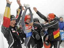 Anke Wischnewski of Germany, left, winner Tatjana Huefner of Germany, and coach Martin Hillebrand celebrate in the ice channel during the Luge World Cup race in Winterberg, Germany on Sunday. The World Cup win was the 100th World Cup win for the German national team in a women's World Cup luge race.