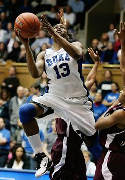 Duke Blue Devils forward Karima Christmas heads to the basket to score two of her 11 points.