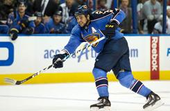 Atlanta Thrashers defenseman Dustin Byfuglien is racking up the points with his intimidating shot.
