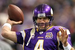 Minnesota Vikings quarterback Brett Favre attempts throwing on the sidelines after an injury in the first quarter of their game against the Buffalo Bills in Minneapolis.