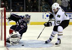 Blue Jackets goalie Mathieu Garon makes a huge save on a shot by the Stars' Jamie Benn during Columbus' shootout victory.