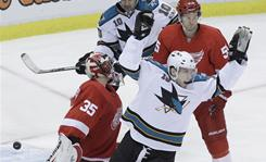 Sharks right wing Dany Heatley, front right, celebrates his goal against Red Wings goalie Jimmy Howard during the second period.