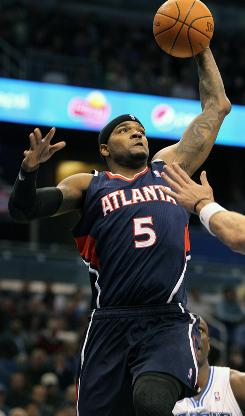 Hawks power forward Josh Smith dunks against the Magic during the first half Monday. Smith finished with 19 points and the Hawks won 80-74.