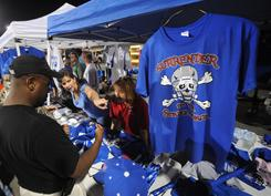 Byrnes High School in South Carolina decided to trademark its logo last year so it could pocket some of the profits from team merchandise sales. Rebels booster club volunteers assist Len Starks with a selection.