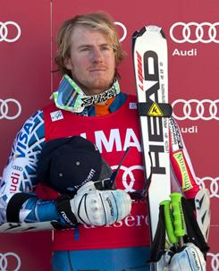 Ted Ligety on the podium after winning the FIS alpine skiing World Cup giant slalom race on the Bellevarde race piste Val D'Isere.