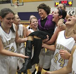 Granbury Lady Pirates basketball head coach Leta Andrews is carried off the court following their win over Midlothian in Granbury, Texas, her 1,334th.