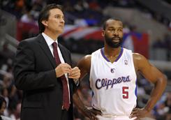 Los Angeles Clippers guard Baron Davis, right, is averaging 8.5 points and 6.4 assists a game while the Clippers own a 5-17 record.