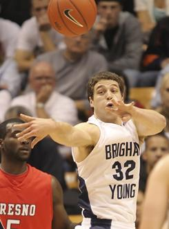 BYU's Jimmer Fredette, a preseason All-American, pulled his name from the NBA draft to return to BYU.