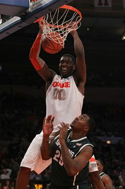 Rick Jackson of Syracuse dunks for two of his 17 points in a win over Michigan State in New York.