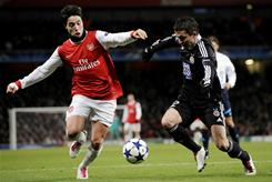 Arsenal midfielder Samir Nasri, left, vying for the ball with Partizan Belgrade midfielder Sasa Ilic , scored the game's final goal in the 77th minute to seal the Arsenal's 3-1 win.