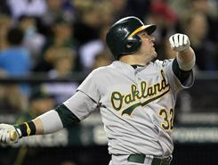 Jack Cust is set to leave the Oakland Athletics for AL West rival Seattle. Cust will become the Mariners regular designated hitter in 2011.