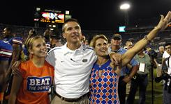 "Florida coach Urban Meyer and his wife, Shelley, right, and daughter Gigi, left, celebrate after last year's Georgia game. Meyer cited his family as a reason for his retirement from the Gators. In a statement released by the university on Wednesday, Meyer said, ""it is time to put my focus on my family and life away from the field."""