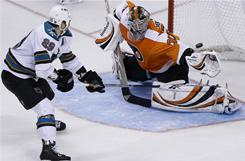 The Sharks' Ryane Clowe, scoring past Flyers goalie Sergei Bobrovsky during the shootout, helped San Jose rally for a 5-4 win in Philadelphia.