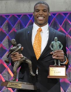 Auburn's Cam Newton poses with the Davey O'Brien Award, left, after winning it for being the best quarterback and the Maxwell Award, presented to the best all-around player, at the Home Depot ESPNU College Football Awards in Lake Buena Vista, Fla., on Thursday.