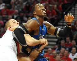 Orlando Magic center Dwight Howard battles for position under the basket with Portland Trail Blazers center Joel Przybilla during the first quarter on Thursday. The Blazers won 97-83.