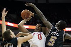Ohio State forward Jared Sullinger puts a shot up between IUPUI defenders in the Buckeyes' 75-64 win. Sullinger finished with 40 points, an Ohio State freshman record.