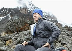 Martina Navratilova, taking a break after ascending to 4,500 meters on Day 4 of her hike up Mount Kilimanjaro, had to abandon her efforts due to the effects of high altitude on her lungs.