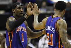 New York Knicks forward Amar'e Stoudemire (1) and teammate Wilson Chandler (21) high-five at the end of Friday's game. The Knicks won 101-95, and Stoudemire turned in his seventh consecutive 30-point game.