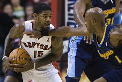 Toronto Raptors forward Amir Johnson guards the ball from Denver Nuggets guard Chauncey Billups during first-half action on Friday. The Nuggets won 123-116, giving coach George Karl his 1,000th NBA win.